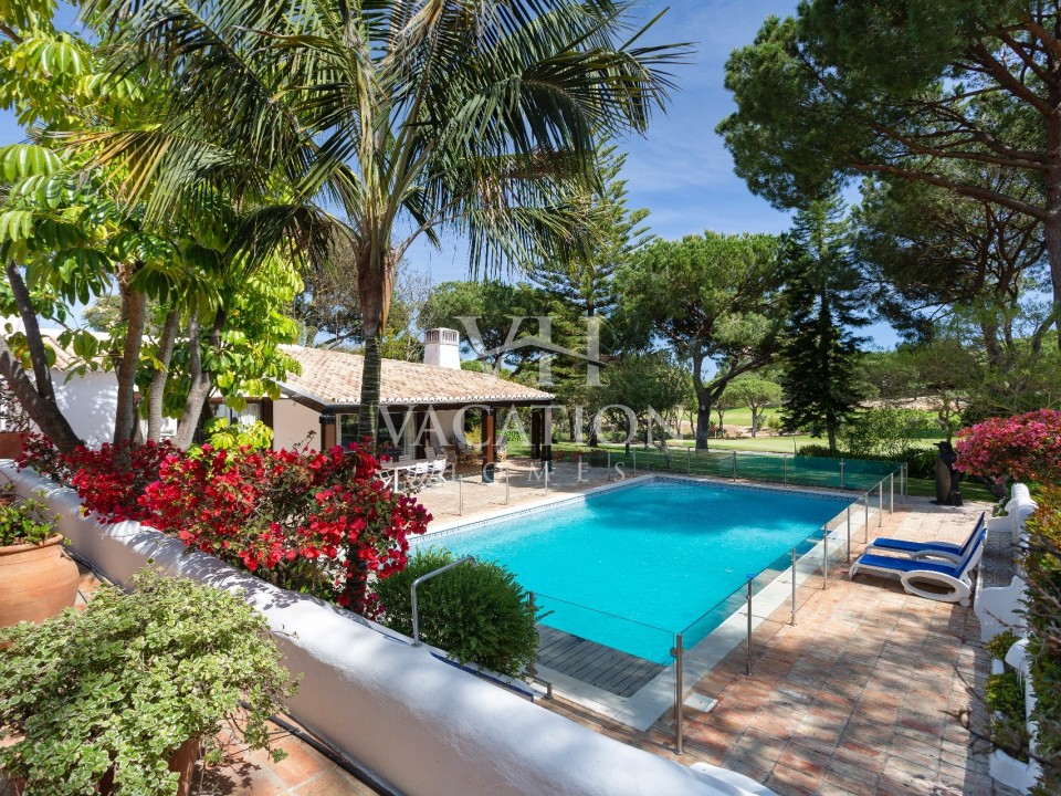Beautiful traditional property adjoining golf course with private pool.